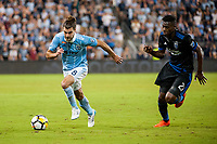 Kansas City, KS - Wednesday August 9, 2017: Graham Zusi, Fatai Alashe during a Lamar Hunt U.S. Open Cup Semifinal match between Sporting Kansas City and the San Jose Earthquakes at Children's Mercy Park.