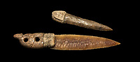 Brown obsidian dagger with a bone handle carved into the shape of a snake. It is believed this may have been a ritual dagger. Catalhoyuk Collections. Museum of Anatolian Civilisations, Ankara. Against a black background