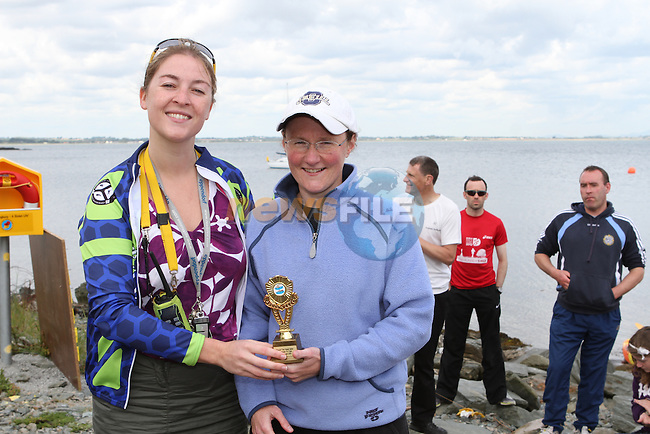 "Sue McKinney presents Alison Cardwell who came Ladies second at the Clogherhead ""Round the Head Swim""....(Photo credit should read Jenny Matthews/NEWSFILE)..."