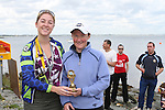 """Sue McKinney presents Alison Cardwell who came Ladies second at the Clogherhead """"Round the Head Swim""""....(Photo credit should read Jenny Matthews/NEWSFILE)..."""
