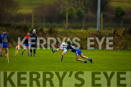 Castlegregory's William Goodwin gets his shot off despite the efforts of Adam Shanagher of Rathkeale during the Munster U18 football final in Duagh on Friday last.