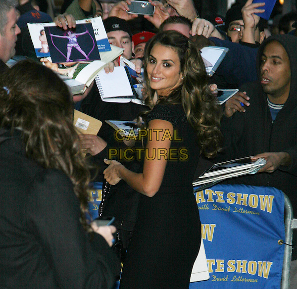 PENELOPE CRUZ.Appearance on the 'Late Show with David Letterman' at the Ed Sullivan Theater, November 17th, 2009..half length black dress looking over shoulder back rear behind cap sleeve .CAP/LNC/TOM.©LNC/Capital Pictures.