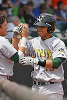 Neftali Soto #19 of the Lynchburg Hillcats being congratulated coming back to the dugout after hitting a home run during a game against the Kinston Indians at Granger Stadium on April 28, 2010 in Kinston, NC. Photo by Robert Gurganus/Four Seam Images.