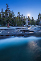 Full moon illuminates night sky over Lyell fork of Tuolumne river, Yosemite national park, California, USA