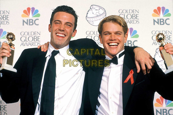 BEN AFFLECK & MATT DAMON..Ref: 043..celebrity friends, aids awareness ribbon, award winners, smiling, half length, half-length..www.capitalpictures.com..sales@capitalpictures.com..Supplied by Capital Pictures