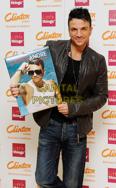 PETER ANDRE.signs copies of his new 2011 calendar at Clinton's Cards, Bluewater Shopping Centre, Kent, England, UK,.5th February 2011..half length jacket holding jeans necklace black leather stubble facial hair  .CAP/DH.©David Hitchens/Capital Pictures.