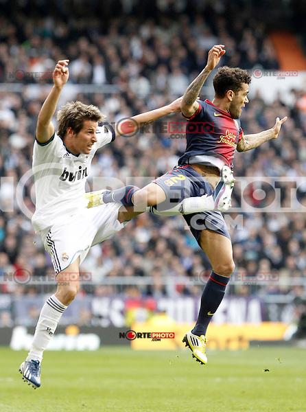 Real Madrid's Fabio Coentrao (l) and FC Barcelona's Daniel Alves during La Liga match.March 02,2013. (ALTERPHOTOS/Acero) /NortePhoto