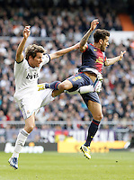 Real Madrid's Fabio Coentrao (l) and FC Barcelona's Daniel Alves during La Liga match.March 02,2013. (ALTERPHOTOS/Acero) /NortePhoto