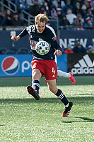 FOXBOROUGH, MA - MARCH 7: Henry Kessler #4 of New England Revolution kicks a ball to the sideline to stop the Chicago Fire advance towards goal during a game between Chicago Fire and New England Revolution at Gillette Stadium on March 7, 2020 in Foxborough, Massachusetts.