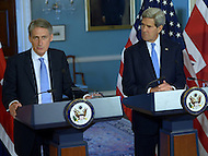 Washington, DC - October 8, 2014: U.S. Secretary of State John Kerry (r) and U.K. Foreign Secretary Philip Hammond discuss the U.S. and U.K. response to ISIL and Ebola during a joint press availability in the Treaty Room at the Department of State, October 8, 2014.   (Photo by Don Baxter/Media Images International)