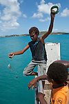 Torres Strait Islander kids fishing off the jetty at Horn Island, Torres Strait Islands, Queensland, Australia
