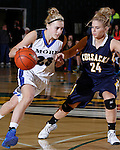 SPEARFISH, S.D. -- March 14, 2014 -- Alexys Swedlund #23 of St. Thomas More drives on Anna Keefe #24 of Sioux Valley during their semifinal game at the 2014 South Dakota State A Girls Basketball Tournament at the Donald E. Young Center in Spearfish, S.D. Friday. (Photo by Dick Carlson/Inertia)