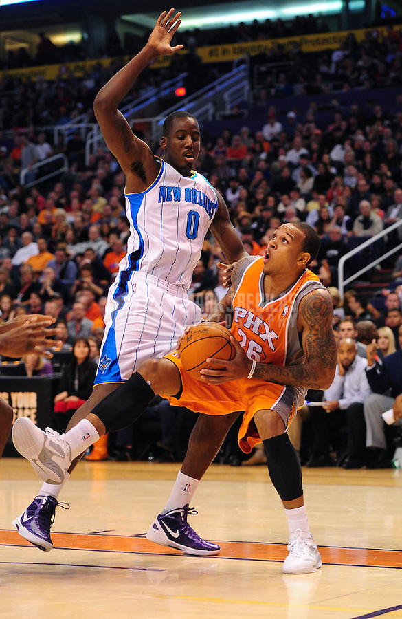 Dec. 26, 2011; Phoenix, AZ, USA; Phoenix Suns guard Shannon Brown (right) drives to the basket against New Orleans Hornets forward Al-Farouq Aminu at the US Airways Center. The Hornets defeated the Suns 85-84. Mandatory Credit: Mark J. Rebilas-USA TODAY Sports