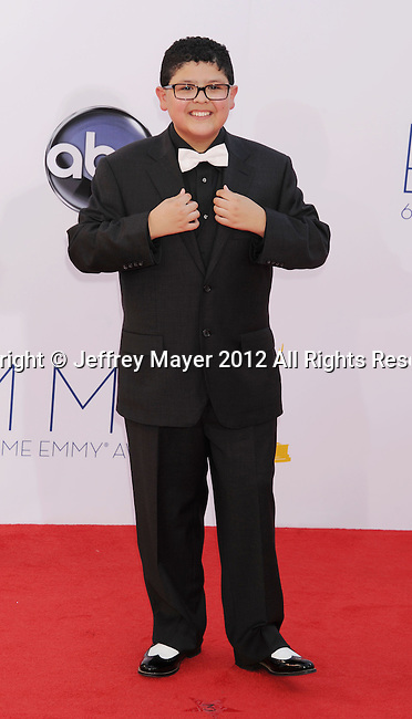 LOS ANGELES, CA - SEPTEMBER 23: Rico Rodriguez arrives at the 64th Primetime Emmy Awards at Nokia Theatre L.A. Live on September 23, 2012 in Los Angeles, California.
