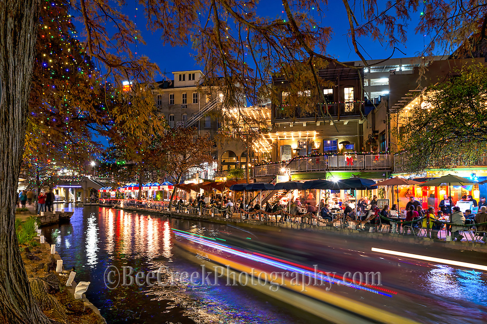 This is an iholiday mage of the San Antonio riverwalk at Christmas time.  The restaurants had their christmas lights and decorations up and the trees had colorful christmas lights hanging down and even the river boats had holiday decorations so the mood was very festive with holiday cheer!