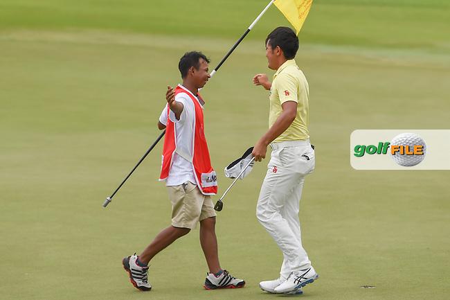 Takumi KANAYA (JPN) hugs his caddie after winning the Asia-Pacific Amateur Championship, Sentosa Golf Club, Singapore. 10/7/2018.<br /> Picture: Golffile   Ken Murray<br /> <br /> <br /> All photo usage must carry mandatory copyright credit (© Golffile   Ken Murray)