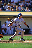OAKLAND, CA - Johnny Damon of the Kansas City Royals bats during a game against the Oakland Athletics at the Oakland Coliseum in Oakland, California on April 26, 1997. Photo by Brad Mangin