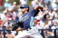 Tampa Bay Rays pitcher Cesar Ramos #27 delivers a pitch during a spring training game against the Baltimore Orioles at the Charlotte County Sports Park on March 5, 2012 in Port Charlotte, Florida.  (Mike Janes/Four Seam Images)