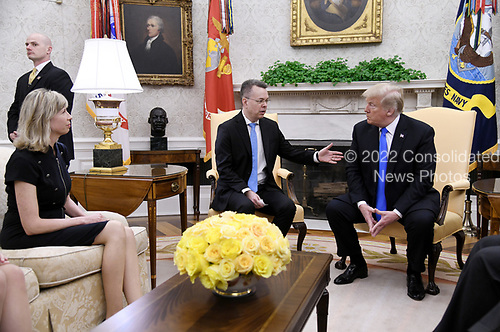 Pastor Andrew Brunson talks to U.S. President Donald Trump in the Oval Office of the White House on October 13, 2018 in Washington, DC. Pastor Andrew Brunson arrived back in the U.S. on Saturday after being held in Turkey for two years on terrorism charges. <br /> Credit: Olivier Douliery / Pool via CNP