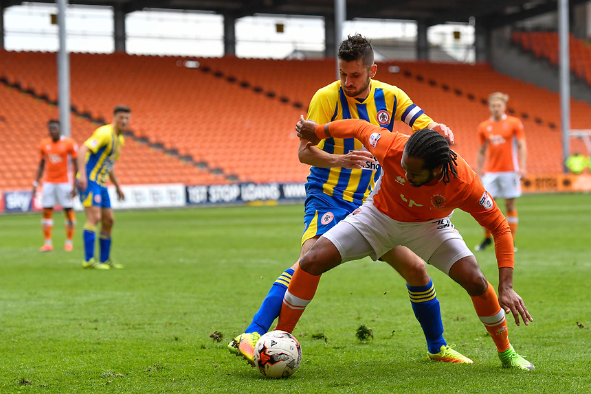 Blackpool's Nathan Delfounso under pressure from Accrington Stanley's Seamus Conneely<br /> <br /> Photographer Terry Donnelly/CameraSport<br /> <br /> The EFL Sky Bet League Two - Blackpool v Accrington Stanley - Friday 14th April 2017 - Bloomfield Road - Blackpool<br /> <br /> World Copyright &copy; 2017 CameraSport. All rights reserved. 43 Linden Ave. Countesthorpe. Leicester. England. LE8 5PG - Tel: +44 (0) 116 277 4147 - admin@camerasport.com - www.camerasport.com