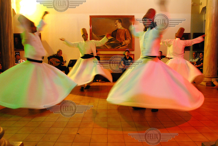 Whirling Dervishes, members of a Sufi religious order who go into a trance as they spin in prayer. Sufism.