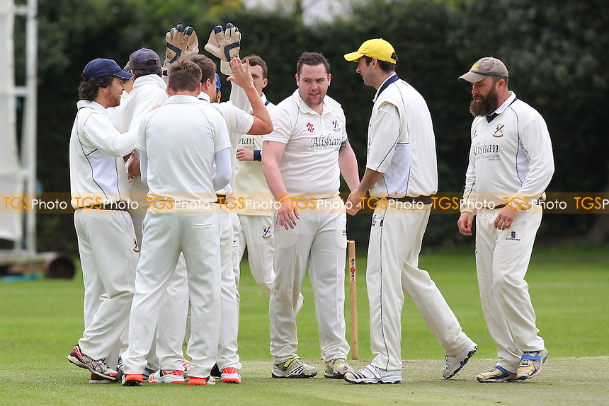 Upminster players celebrate the first Southend wicket - Upminster CC vs Southend-on-Sea & EMT CC (batting) - Essex Cricket League - 09/05/15 - MANDATORY CREDIT: Gavin Ellis/TGSPHOTO - Self billing applies where appropriate - 0845 094 6026 - contact@tgsphoto.co.uk - NO UNPAID USE