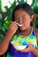 Girl with shave ice in a dish, crushed ice with flavorful syrup