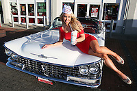 07/12/11 ***NO REPRODUCTION FEE***Model Tiffany Stanley pictured  in a 1958 Buick at Eddie Rockets Diner, Walkinstown this morning where she launched the Eddie Rocket's Christmas Pudding Shake, which goes on sale at City Dinners and Shake Shops nationwide today..The shake includes three scoops of 100% Irish Ice Cream and a chunk of Plum Pudding, hand dipped and topped with Whipped Cream and Cinnamon,.Every time  a Christmas Pudding Shakeis bought  in December, Eddie Rockets franchisees will donate EUR1 to Irish Osteoporosis Society which faces closure this year if they do not receive urgent funding..The Christmas Pudding Shake is joined on Eddie Rocket's festive menu by another seasonal treat, Christmas Cake Pops, which can be had for EUR3.50...***NO REPRODUCTION FEE***..Picture Colin Keegan, Collins, Dublin.