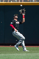 Louisville outfielder Adam Engel (10) makes a running catch against the Oregon State Beavers during Game 5 of the 2013 Men's College World Series on June 17, 2013 at TD Ameritrade Park in Omaha, Nebraska. The Beavers defeated Cardinals 11-4, eliminating Louisville from the tournament. (Andrew Woolley/Four Seam Images)