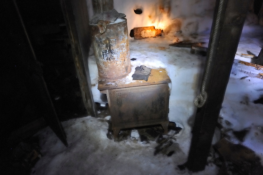 This stove was used to heat water and warm Mawson's Hut.  A large cooking stove seen in contemprory photographs was either returned with the Expedition or removed from the hut and abandoned when they left in 1913.
