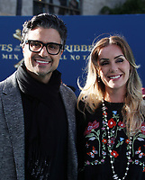 "HOLLYWOOD, CA - May 18: Jaime Camil, Heidi Balvanera, At Premiere Of Disney's ""Pirates Of The Caribbean: Dead Men Tell No Tales"" At Dolby Theatre In California on May 18, 2017. Credit: FS/MediaPunch"