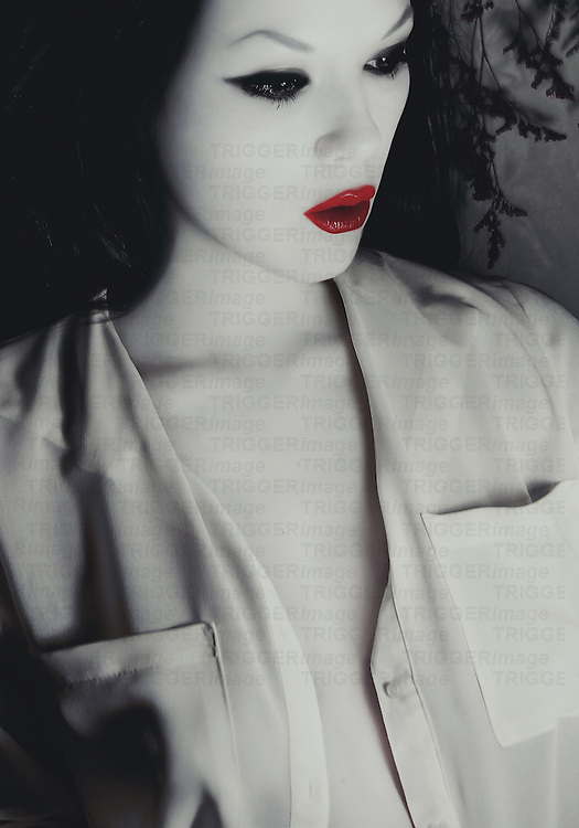 Portrait of woman with red lips and pale skin.