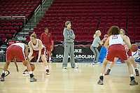 FRESNO, CA--Assistant Coach Amy Tucker give encouragement to her team during practice at the Save Mart Center for the 2012 NCAA Championships.