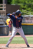 Cedar Rapids Kernels shortstop Wander Javier (15) at bat during a Midwest League game against the Beloit Snappers on June 2, 2019 at Pohlman Field in Beloit, Wisconsin. Beloit defeated Cedar Rapids 6-1. (Brad Krause/Four Seam Images)
