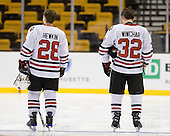Mike Hewkin (NU - 28), Dylan Wiwchar (NU - 32) - The Northeastern University Huskies defeated the Harvard University Crimson 4-1 (EN) on Monday, February 8, 2010, at the TD Garden in Boston, Massachusetts, in the 2010 Beanpot consolation game.