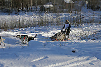 Saturday, February 24th, Knik, Alaska.  Jr. Iditarod musher Ava Linder on the trail shortly after leaving the Knik start