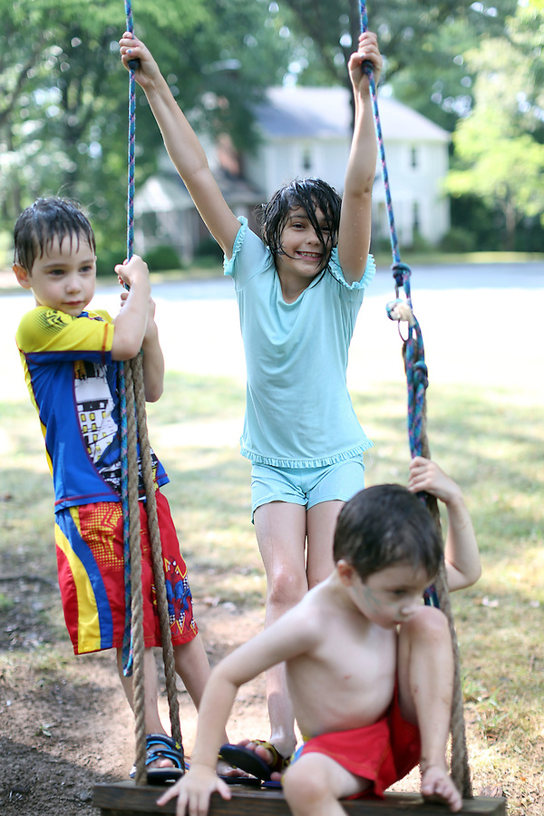 Ava, Cohen and Cooper on the swing in the front yard in Charlottesville, Va. Photo/Andrew Shurtleff