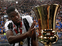 Calcio, finale Tim Cup: Milan vs Juventus. Roma, stadio Olimpico, 21 maggio 2016.<br /> Juventus' Paul Pogba touches the trophy at the end of the Italian Cup final football match between AC Milan and Juventus at Rome's Olympic stadium, 21 May 2016. Juventus won 1-0 in the extra time.<br /> UPDATE IMAGES PRESS/Isabella Bonotto