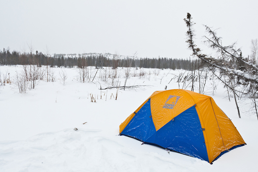 A Sierra Designs tent is seen in the snow.