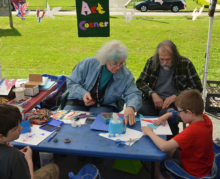 Anita Barbour, entertaining children at the Craft Corner, at the Opening Day of the 2017 Saugerties Farmer's Market on Saturday, May 27, 2017. Photo by Jim Peppler. Copyright/Jim Peppler-2017.
