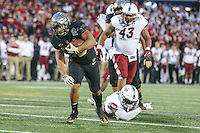 Annapolis, MD - December 27, 2016: Wake Forest Demon Deacons running back Matt Colburn (22) breaks a tackle during game between Temple and Wake Forest at  Navy-Marine Corps Memorial Stadium in Annapolis, MD.   (Photo by Elliott Brown/Media Images International)