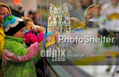 10 January 2009: A young University of Vermont Catamount hockey fan holds up a set of hockey cards prior to a game against the Boston College Eagles in the second matchup of a weekend series at Gutterson Fieldhouse in Burlington, Vermont. The Catamounts rallied from an early 2-0 deficit to defeat the visiting Eagles 4-2. Mandatory Photo Credit: Ed Wolfstein Photo