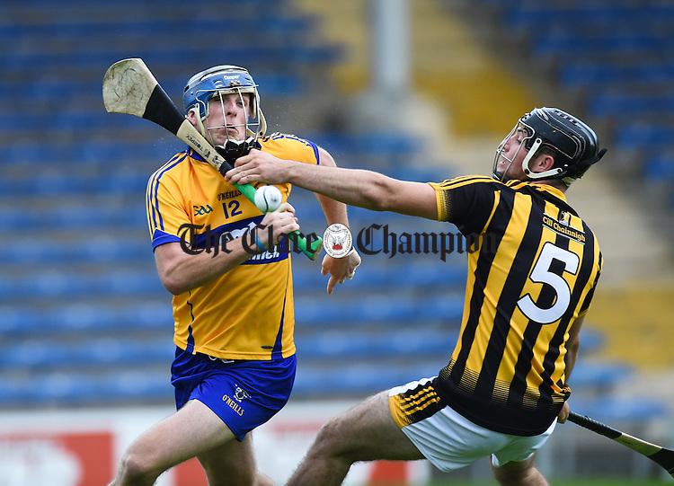 Darragh Corry of Clare in action against Jason Cleere of Kilkenny during their Intermediate All-Ireland final at Thurles. Photograph by John Kelly.