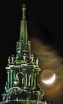 A combination of heavy clouds, a wisp of fog, the waxing of fog, the waxing moon and the top of the San Francisco's City Hall dome mad for a scene reminiscent of the super-hero Batman's Mythical hometown. ..