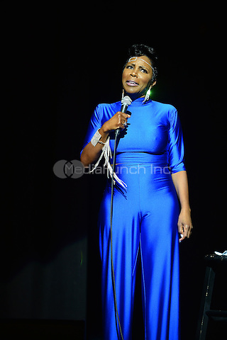 MIAMI, FL - JANUARY 17:  Sommore performs on stage at the Festival of Laughs - Day 2  at the James L Knight Center on January 17, 2015 in Miami, Florida.  Credit: MPI10 / MediaPunch