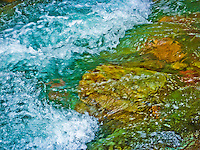 Agitated turquoise of Baring Creek in the Sunrift Gorge Glacier National Park