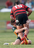 Mitch Williams of the Wyong Roos stops Latu Fifita of the North Sydney Bears during the first trail game of the 2013 NSW Cup season at Morrie Breen Oval on February 9, 2013 in Wyong, Australia. (Photo by Paul Barkley/LookPro)
