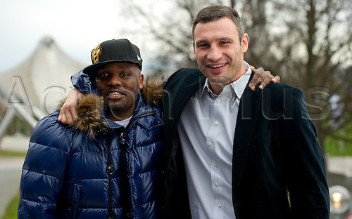 WBC Heavyweight World Champion Vitali Klitschko from the Ukraine (R) and British boxer Dereck Chisora pose in front of the Olympic Hall in Munich,Germany, 15 December 2012. Klitschko intends to defend his title against Chisora on 18 February 2012 in Munich.