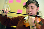 A student plays a violin during music class in the Lydia Paterson Institute in El Paso, Texas. Most of the school's students travel across the border every day from their homes in Juarez, Mexico, to study at the United Methodist-sponsored high school.