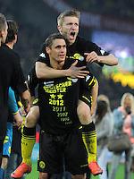 Fussball 1. Bundesliga :  Saison   2010/2011   32. Spieltag  21.04.2012 Borussia Dortmund - Borussia Moenchengladbach Jubel nach dem SIEG zur Deutschen Meisterschaft Sebastian Kehl oben auf Jakub  KUBA Blaszczykowski (Borussia Dortmund)